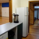 kitchen: eating utensils, fridge, and hot water urn