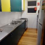 kitchen: cooking utensils, sink, oven, microwave